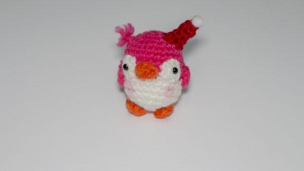 Pingüino de rosa de punto